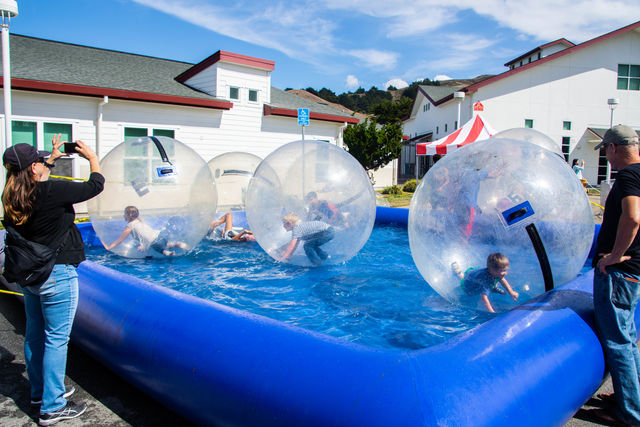 Kids play in inflatable balls in a pool at Fog Fest Pacifica on Sept. 30, 2018
