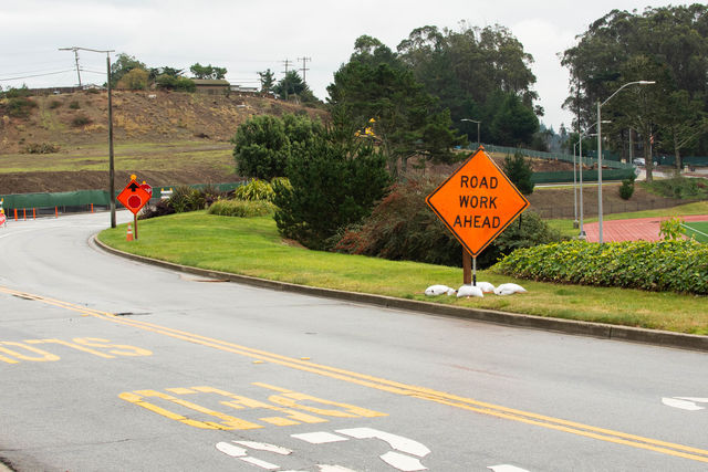 """A """"ROAD WORK AHEAD"""" sign warns drivers of the construction occurring at the College Drive entrance of Skyline College on Dec. 5, 2018."""