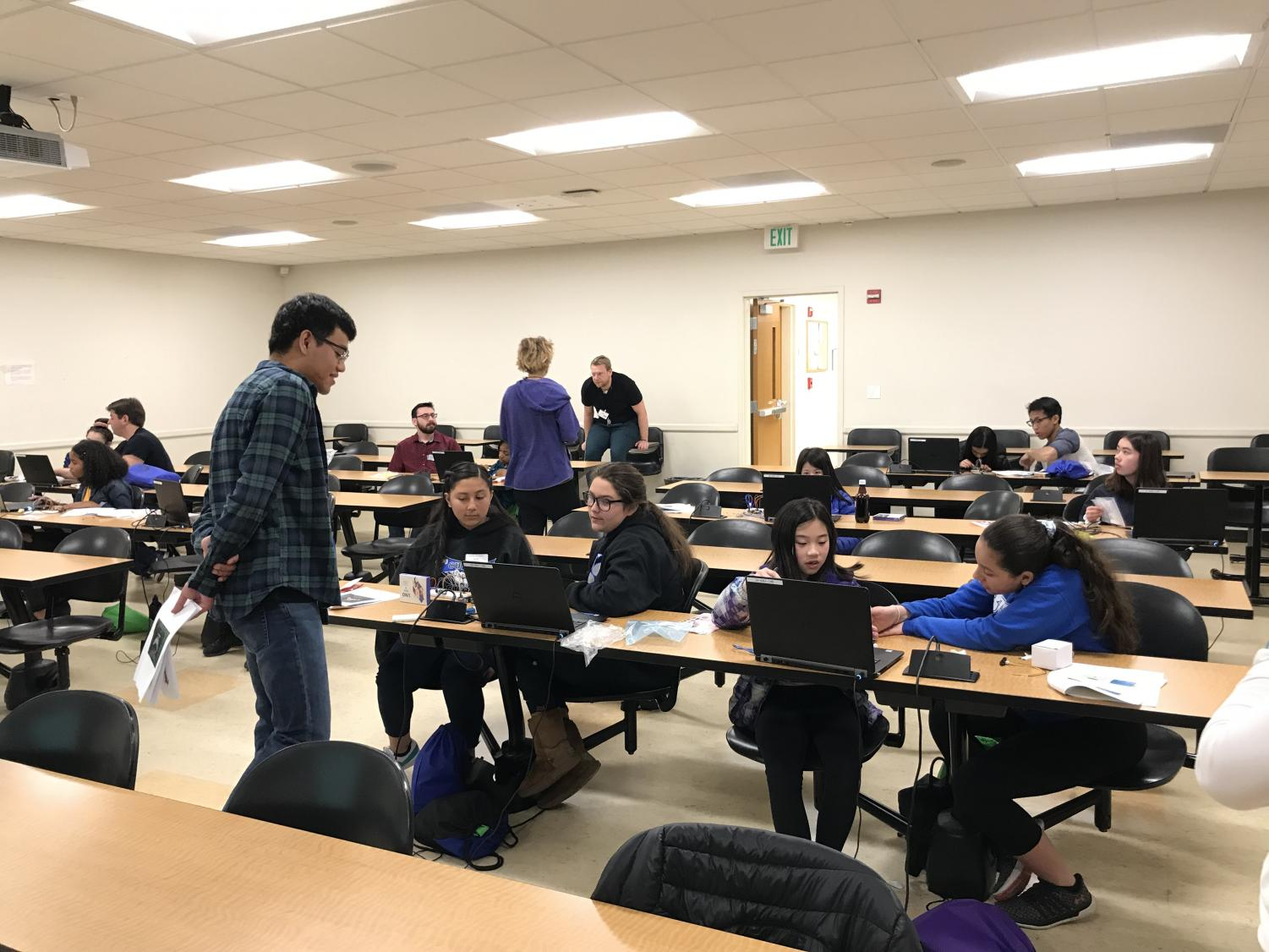 Students who attend the event use laptops to participate in a workshop.