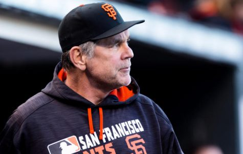 Jul 29, 2016; San Francisco, CA, USA; San Francisco Giants manager Bruce Bochy (15) watches from the dugout against the Washington Nationals in the first inning at AT&T Park. Mandatory Credit: John Hefti-USA TODAY Sports