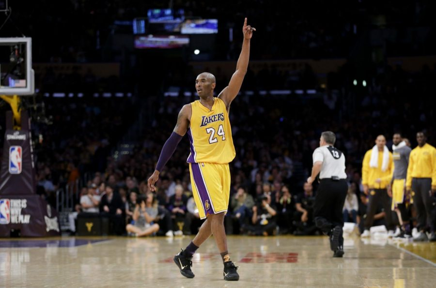 Los Angeles Lakers' Kobe Bryant acknowledges the fans after the last NBA basketball game of his career, against the Utah Jazz on Wednesday, April 13, 2016, in Los Angeles.