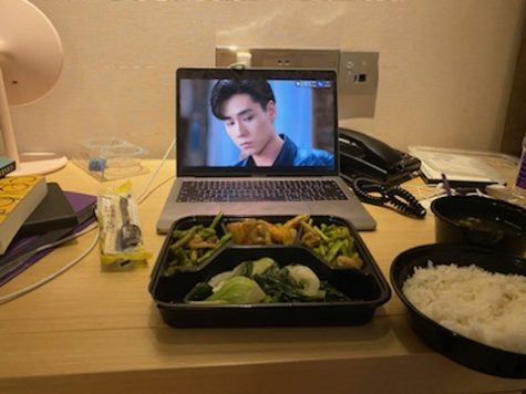 A laptop lays on a table at a quarantine center with meal in Guangzhou, China.
