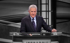 Alex Trebek at the podium where he served as host of Jeopardy! for over 30 years.