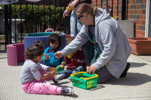 Toddlers playing with a Loma Chica staff way back in 2016.