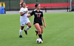Keely Anderberg dribbles the ball upfield for Skylines women's soccer team