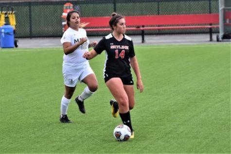 Keely Anderberg dribbles the ball upfield for Skylines women's soccer team